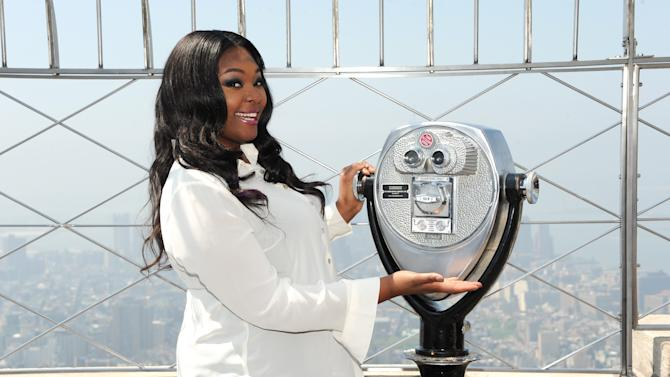 """Candice Glover,""""American Idol"""" season 12 winner, visits the Empire State Building's 86th floor Observatory on Tuesday, May 21, 2013 in New York. (Photo by Evan Agostini/Invision/AP)"""