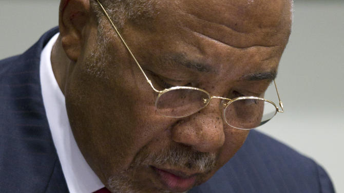 Former Liberian President Charles Taylor looks down as he waits for the start of a hearing to deliver verdict in the court room of the Special Court for Sierra Leone in Leidschendam, near The Hague, Netherlands, Thursday April 26, 2012. Judges were expected to deliver landmark judgements in the trial against the former president who is charged with supporting notoriously brutal rebels in neighboring Sierra Leone. (AP Photo/Peter Dejong, Pool)