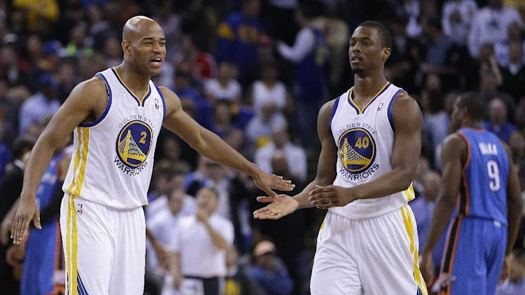 Golden State Warriors' Jarrett Jack, left, and Harrison Barnes (40) celebrate during a timeout in the second half of an NBA basketball game against the Oklahoma City Thunder Wednesday, Jan. 23, 2013, in Oakland, Calif. (AP Photo/Ben Margot)