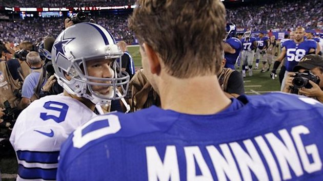 Dallas Cowboys quarterback Tony Romo (L) greets New York Giants quarterback Eli Manning (10) after defeating the Giants in New Jersey (Reuters)