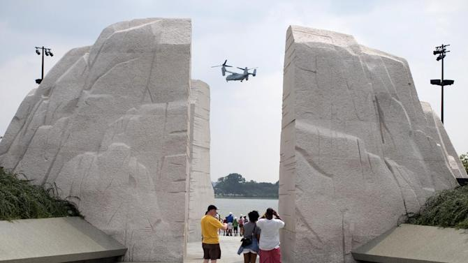 "A Osprey military helicopter flies by the Martin Luther King Jr. Memorial in Washington, Tuesday, Aug. 27, 2013. Barack Obama, who will speak, was 2 years old and growing up in Hawaii when Martin Luther King Jr. delivered his ""I Have a Dream"" speech from the steps of the Lincoln Memorial. Fifty years later, the nation's first black president will stand as the most high-profile example of the racial progress King espoused, delivering remarks at a nationwide commemoration of the 1963 demonstration for jobs, economic justice and racial equality. (AP Photo/Carolyn Kaster)"