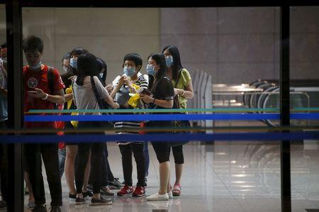 Passengers wearing masks to prevent contracting Middle East Respiratory Syndrome (MERS) wait for train at Incheon International Airport in Incheon