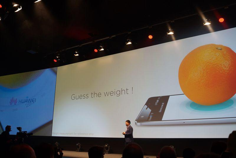 Huawei just weighed an orange on stage with its new smartphone