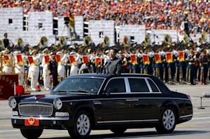 File photo of Chinese President Xi Jinping standing in a car, at the beginning of the military parade marking the 70th anniversary of the end of World War Two, in Beijing