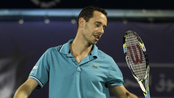 Michael Llodra of France reacts after losing a point to Roger Federer of Switzerland during the Emirates Dubai ATP Tennis Championships in Dubai, United Arab Emirates, Tuesday, Feb. 28, 2012. (AP Photo/Hassan Ammar)
