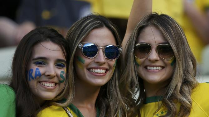 Fans of Brazil wait for the start of their 2014 World Cup quarter-finals against Colombia at the Castelao arena in Fortaleza