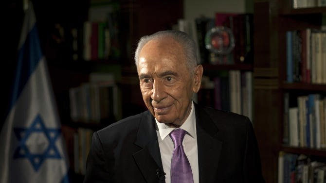 In this photo taken Sunday, June 16, 2013, Israel's President Shimon Peres, is seen during an interview with The Associated Press at the President's residence in Jerusalem. As Shimon Peres turns 90, the indefatigable Israeli president is doing what he has always done: looking ahead, preparing for the next challenge and believing that he will see Middle East peace in his lifetime. (AP Photo/Sebastian Scheiner)