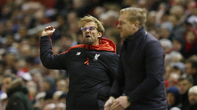 Liverpool manager Juergen Klopp and Swansea manager Garry Monk