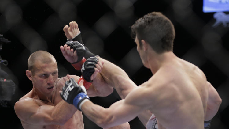 Donald Cerrone, left, blocks a kick by Karl Noons in the first round of a lightweight mixed martial arts bout during UFC 160, Saturday, May 25, 2013, in Las Vegas. Cerrone won by unanimous decision. (AP Photo/Julie Jacobson)