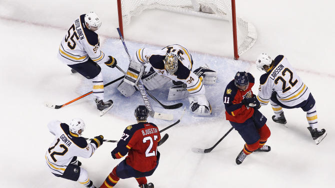 Buffalo Sabres goaltender Michal Neuvirth (34) stops a shot by Florida Panthers forward Nick Bjugstad (27) during the second period of an NHL hockey game, Saturday, Feb. 28, 2015, in Sunrise, Fla. The Panthers defeated the Sabres 5-3. (AP Photo/Joel Auerbach)