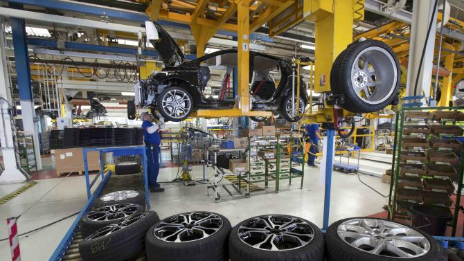 Employees of French carmaker Renault work on the Clio RS assembly line at Renault factory in Dieppe