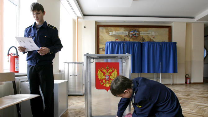 Russian cadets prepare for Sunday's presidential election at a polling station in Rostov-on-Don, Russia, Saturday, March 3, 2012.  The Russian presidential election will be held in Russia on Sunday, March 4.   (AP Photo)