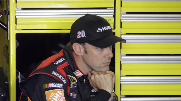 Matt Kenseth looks on as crew members work on his car during practice for Sunday's NASCAR Sprint Cup series Coca-Cola 600 auto race at Charlotte Motor Speedway in Concord, N.C., Thursday, May 23, 2013. (AP Photo/Nell Redmond)