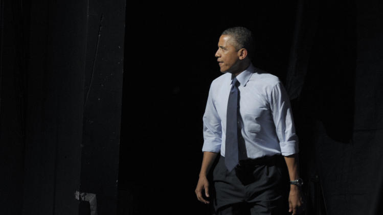 President Barack Obama walks on stage to speak at a fundraising event at the Austin Music Hall in Austin, Texas, Tuesday, July 17, 2012. Obama is spending the day fundraising in Texas. (AP Photo/Susan Walsh)