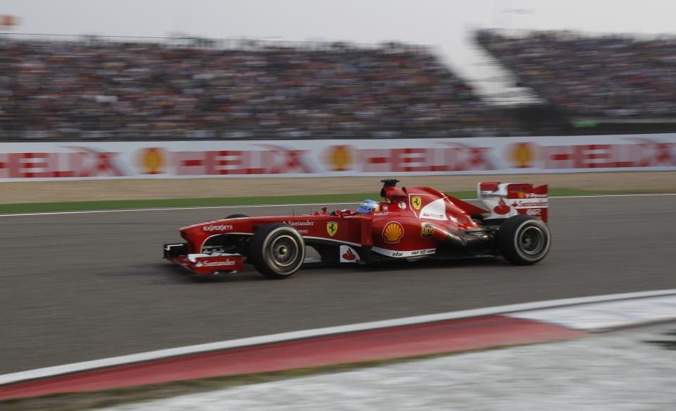 Ferrari driver Fernando Alonso of Spain takes a corner on his way to winning the Chinese Formula One Grand Prix in Shanghai, China Sunday, April 14, 2013. (AP Photo/Greg Baker)