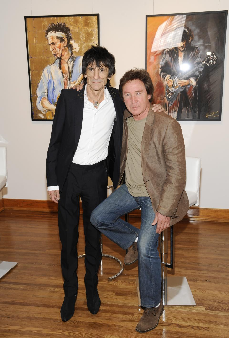 "Rolling Stones guitarist Ronnie Wood and drummer Kenney Jones pose for a photo during a news conference unveiling Wood's new art exhibit ""Faces, Time and Places"" on Monday, April 9, 2012, in New York. (AP Photo/Evan Agostini)"