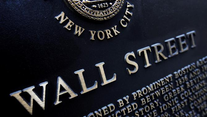 FILE - This Jan. 4, 2010 file photo shows an historic marker on Wall Street in New York. U.S. stocks are opening lower Friday, July 11, 2014, and are headed for their biggest weekly loss since April. (AP Photo/Mark Lennihan, File)