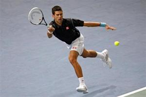Djokovic of Serbia prepares to return the ball to Isner of the U.S. at the Paris Masters men's singles tennis tournament at the Palais Omnisports of Bercy in Paris