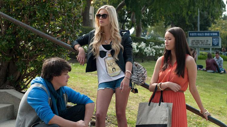 "This publicity image released by A24 Films shows, from left, Israel Broussard, Claire Vivien and Katie Chang in a scene from ""The Bling Ring."" (AP Photo/A24 Films, Merrick Morton)"