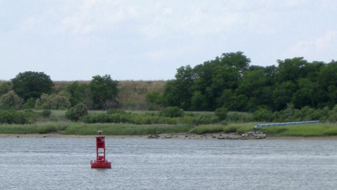 This May 4, 2012, photo shows a buoy from Old Fort Jackson marking the shipwreck of the CSS Georgia, a Confederate warship that sank in the Savannah River nearly 148 years ago, in Savannah, Ga. The Army Corps of Engineers plans to spend $14 million to raise and preserve the sunken Confederate ironclad to make room for deepening Savannah's harbor. (AP Photo/Russ Bynum)