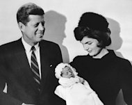 John F Kennedy stands with his wife Jackie and their son John Jr at in the University of Georgetown chapel ahead of his baptism, on December 10, 1960 (AFP Photo/)
