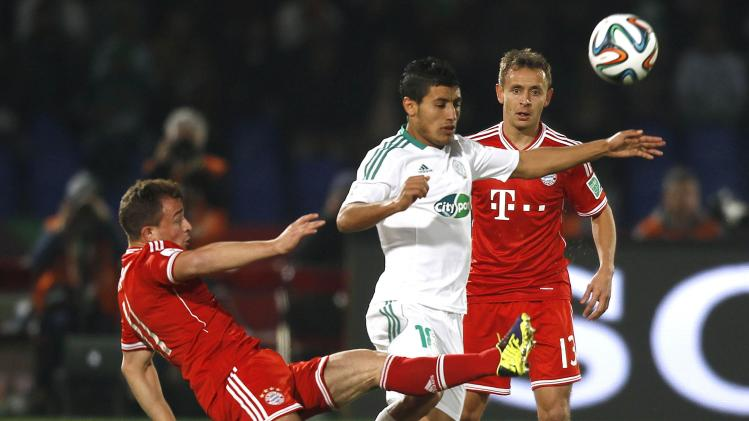 Hafidi of Morocco's Raja Casablanca fights for the ball with Shaqiri of Germany's Bayern Munich during their 2013 FIFA Club World Cup final soccer match at Marrakech stadium