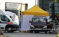 Police forensics tents and officers are seen in Woolwich, east London, on May 22, 2013. Two men wielding knives butchered and beheaded a man believed to be a soldier in a busy London street, before delivering an Islamist tirade to passers-by