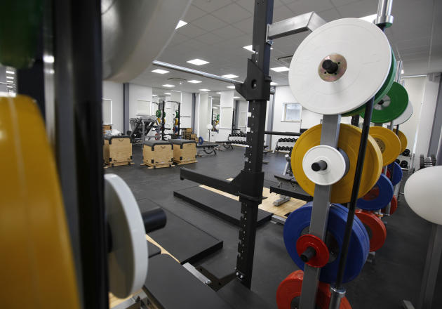 A general view of the University of East London's new weight room at the sports facility on the university's campus in London Thursday, Feb. 9, 2012. A sparkling 21 million-pound ($33.2 million) gym a