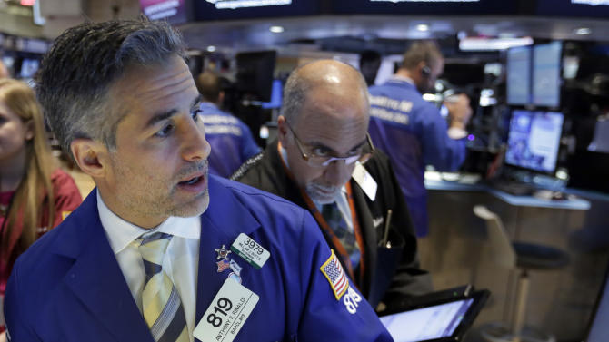 Specialist Anthony Rinaldi, left, and trader John Liotti work on the floor of the New York Stock Exchange, Tuesday, June 30, 2015.  U.S. stocks are rising broadly in early trading as investors hope for a last-minute deal on Greece's debt woes. (AP Photo/Richard Drew)