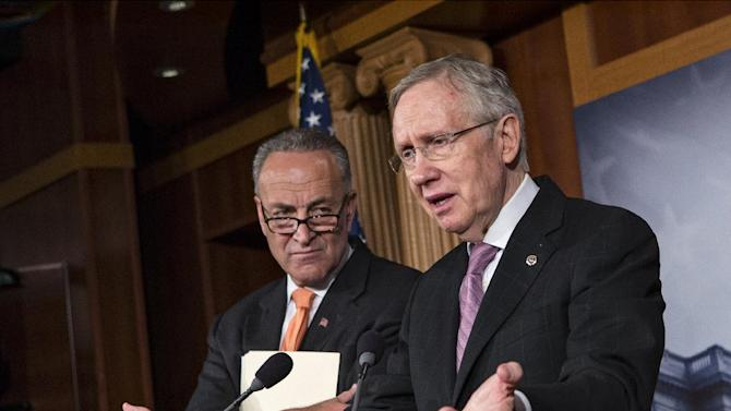 Senate Majority Leader Harry Reid of Nev., right, accompanied by Sen. Charles Schumer, D-N.Y., announces to reporters on Capitol Hill in Washington, Wednesday, Oct. 2, 2013, that President Barack Obama has invited the top leaders in Congress to meet with him at the White House to seek a solution to the government shutdown crisis. A funding cutoff for much of the government began Tuesday as a Republican effort to kill or delay the nation's health care law stalled action on a short-term, traditionally routine spending bill. Lawmakers in both parties have ominously suggested the partial shutdown might last for weeks. (AP Photo/J. Scott Applewhite)