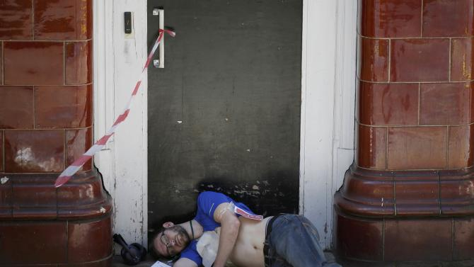 An actor takes part in a mock terror attack at a disused underground station in central London