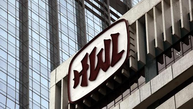 Logo of Hutchison Whampoa Ltd is displayed at one of the company's office towers in Hong Kong