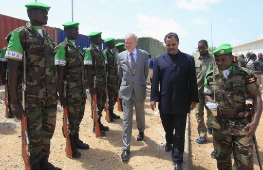 The new U.N. envoy for Somalia Kay inspects a guard of honour mounted by AMISOM forces in Mogadishu Somalia