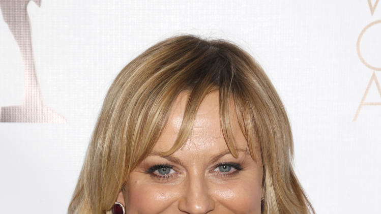 Amy Poehler attends the 2013 Writers Guild Awards at the JW Marriott on Sunday, Feb. 17., 2013 in Los Angeles. (Photo by Todd Williamson/Invision/AP)