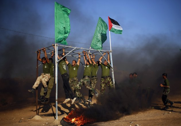Young Palestinians take part in a military-style graduation ceremony organized by the Hamas movement in Rafah