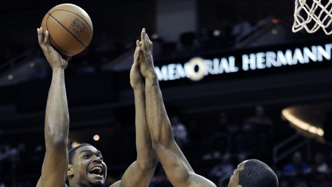 Los Angeles Lakers' Andrew Bynum (17) shoots against Houston Rockets' Marcus Camby (29) in the first half of an NBA basketball game Tuesday, March 20, 2012, in Houston. (AP Photo/Pat Sullivan)