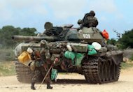 African Union troops move just outside of the Somali capital Mogadishu. African Union and Somali troops launched a long-awaited assault against the Al-Qaeda linked Shebab stronghold of Afgoye