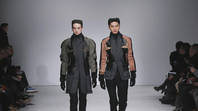 Models wear creations by South Korean fashion designer Juun. J  as part of his presentation for Men's 2013 fall-winter 2013/2014 men's fashion collection, presented in Paris, Friday, Jan.18, 2013. (AP Photo/Jacques Brinon)