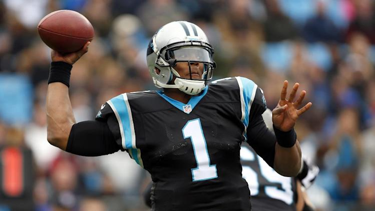 Carolina Panthers' Cam Newton (1) throws a pass against the Tampa Bay Buccaneers during the first half of an NFL football game in Charlotte, N.C., Sunday, Nov. 18, 2012. (AP Photo/Bob Leverone)
