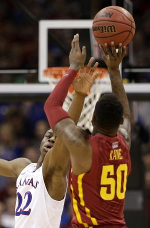 Kansas' Andrew Wiggins (22) tries to block a shot by Iowa State's DeAndre Kane (50) during the first half of an NCAA college basketball game in the Big 12 men's tournament on Friday, March 14, 2014, in Kansas City, Mo. (AP Photo/Charlie Riedel)