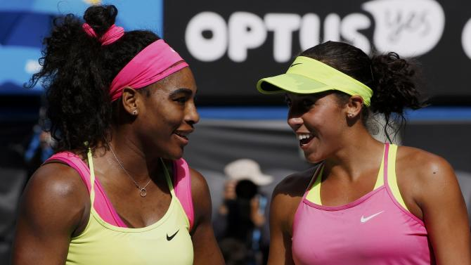 Williams of the U.S. speaks with compatriot Keys after winning their women's singles semi-final match at the Australian Open 2015 tennis tournament in Melbourne