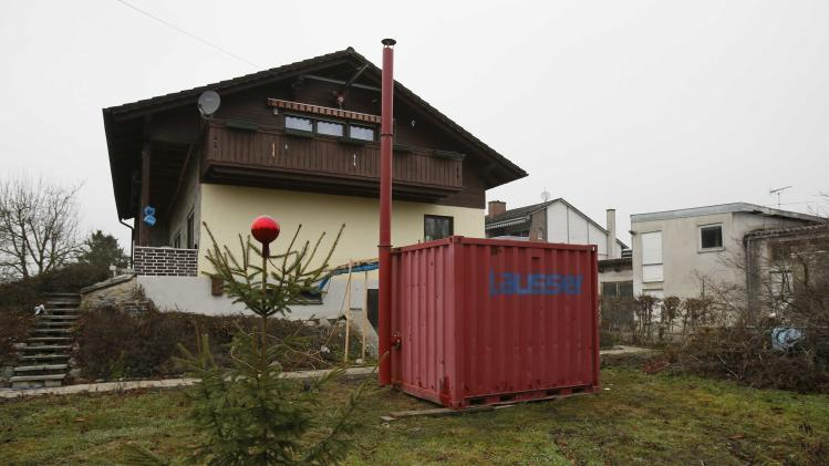 A Christmas tree stands in front of a flood-affected house in Fischerdorf a suburb of the eastern Bavarian city of Deggendorf