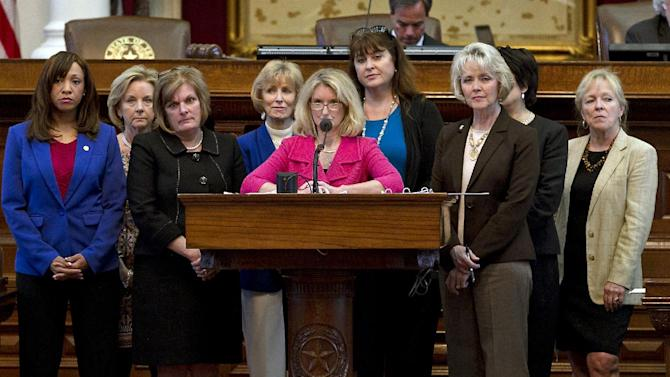 Rep. Jodie Laubenberg, R-Parker, center, sponsor of Senate Bill 5, is flanked by fellow Republicans during the second reading of the abortion bill on the House floor of the Texas State Capitol in Austin, Texas, on Sunday, June 23, 2013. If passed, the bill that would ban abortions after 20 weeks, require that they take place in surgical centers, and restrict where and when women can take abortion-inducing pills, would force 37 out of 42 abortion clinics in Texas to close and undergo millions of dollars in upgrades. (AP Photo/Statesman.com, Rodolfo Gonzalez)