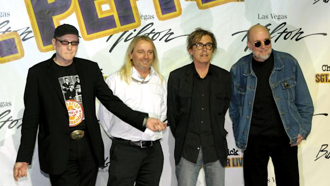 """FILE - In this June 11, 2009 file photo provided by the Las Vegas News Bureau, members of the band Cheap Trick, from left, Rick Nielsen, Robin Zander, Tom Petersson and Bun E. Carlos announce their September 2009 engagement """"Sgt. Pepper Live"""" at the Las Vegas Hilton at a news conference in Las Vegas, Nev. A Delaware judge has dismissed a lawsuit filed by three members of Cheap Trick against the group's former drummer, Brad Carlson, known as Bun E. Carlos, saying the dispute should be decided in Illinois federal court. The three musicians sought court validation of their purported ouster of Carlson as a board member of the band's business entities earlier this year. (AP Photo/Las Vegas News Bureau, Darrin Bush, File) NO SALES"""
