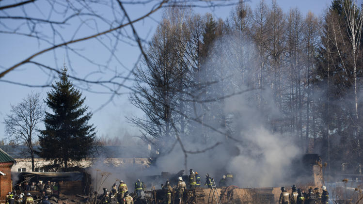 Ministry for Emergency Situations workers and firefighters work at a site of a fire of a psychiatric hospital Friday morning, April 26, 2013. At least 38 people died in a fire in a psychiatric hospital outside Moscow late Thursday night. Police said the fire, which broke out at about 2 a.m. local time (6 p.m. Eastern, 2200 GMT) in the one-story hospital in the Ramenskoye settlement, was caused by a short circuit. (AP Photo/Pavel Sergeyev)