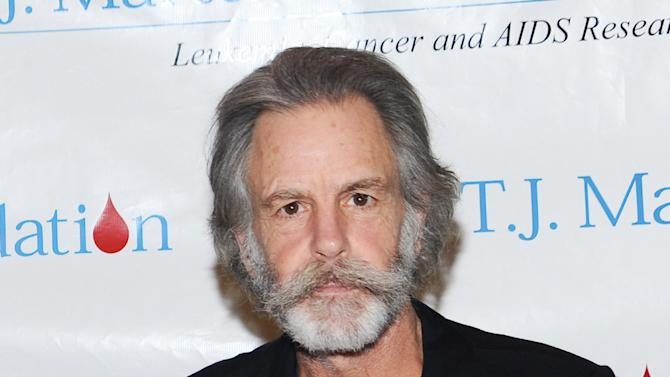 """FILE - This Feb. 24, 2010 file photo shows musician Bob Weir at SIRIUS XM Radio in New York. Weir fell onstage while strumming his guitar at a concert in Port Chester, N.Y. Furthur has cancelled a tour date after guitarist Bob Weir fell onstage at a concert last week. Weir said on his website Tuesday that the band is """"unable to perform for the next several weeks ... due to unforeseen circumstances."""" They were scheduled to play May 9 in Napa, Calif. (AP Photo/Evan Agostini, file)"""