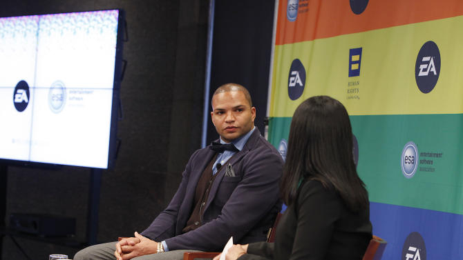 IMAGE DISTRIBUTED FOR EA - NFL linebacker and Super Bowl Champion Brendon Ayanbadejo of the Baltimore Ravens gets interviewed by Maya Harris from the Ford Foundation at Electronic Arts'  LGBT Full Spectrum Event on Thursday, March, 7, 2013 in New York City, New York. (Photo by Amy Sussman/Invision for EA/AP Images)