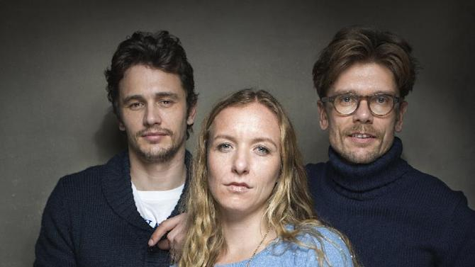 """From left, Producer James Franco, director Christina Voros and filmmaker Travis Mathews from the film """"Kink"""" pose for a portrait during the 2013 Sundance Film Festival, on Sunday, Jan. 20, 2013 in Park City, Utah. (Photo by Victoria Will/Invision/AP Images)"""