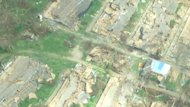 Homes such as these near Roxa were flattened by the storm's sustained winds of 250 km/h.
