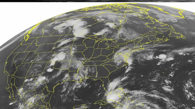This NOAA satellite image taken Saturday, Aug. 25, 2012 at 1:45 a.m. EDT shows a mass of clouds in the Caribbean Sea associated with Tropical Storm Isaac as it pounds Hispaniola with heavy rain and strong wind.  Isaac will continue on its path toward western Cuba and southern Florida through the weekend, possibly gaining hurricane strength.  For more information, please see http://www.wunderground.com/tropical/.  Clouds in the Plains are associated with a front that is producing a few areas of rain and thunderstorms in the area. (AP PHOTO/WEATHER UNDERGROUND)